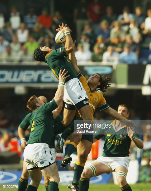 Joe van Niekerk the Springbok number eight catches the ball as George Smith challaneges during the TriNations Rugby Union International between South...