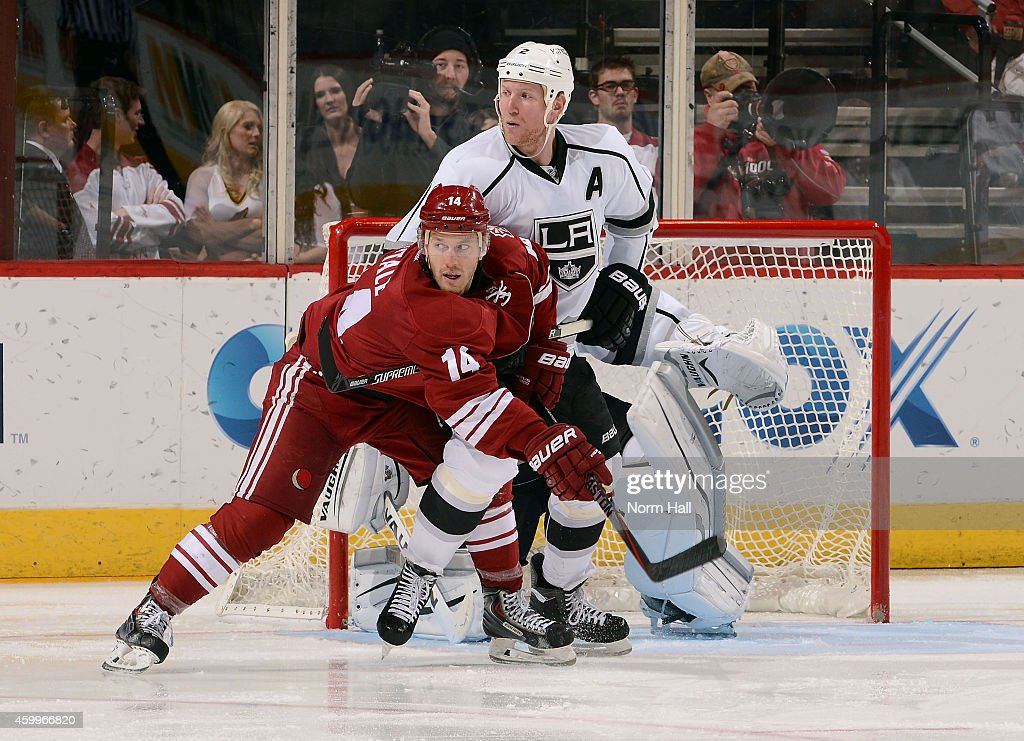 Joe Vitale #14 of the Arizona Coyotes and Matt Greene #2 of the Los Angeles Kings battle for position in front of goaltender Martin Jones #31 of the Kings during the third period at Gila River Arena on December 4, 2014 in Glendale, Arizona.