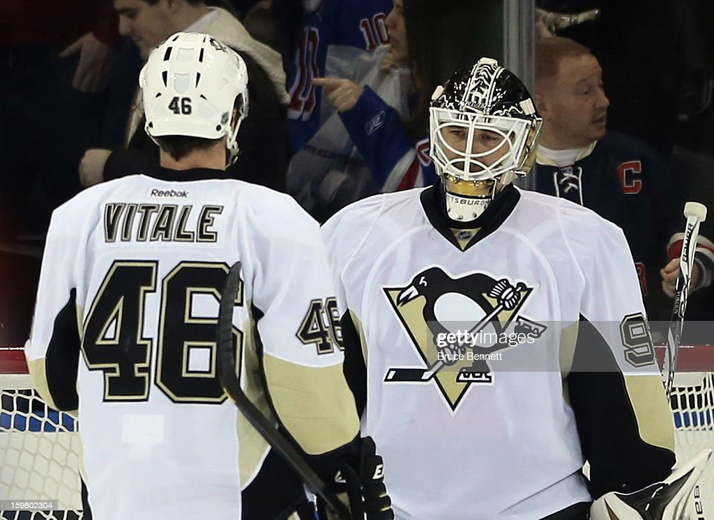 Joe Vitale #46 of the Pittsburgh Penguins greets goaltender <a gi-track='captionPersonalityLinkClicked' href=/galleries/search?phrase=Tomas+Vokoun&family=editorial&specificpeople=202179 ng-click='$event.stopPropagation()'>Tomas Vokoun</a> #92 following his 6-3 victory over the New York Rangers at Madison Square Garden on January 20, 2013 in New York City.