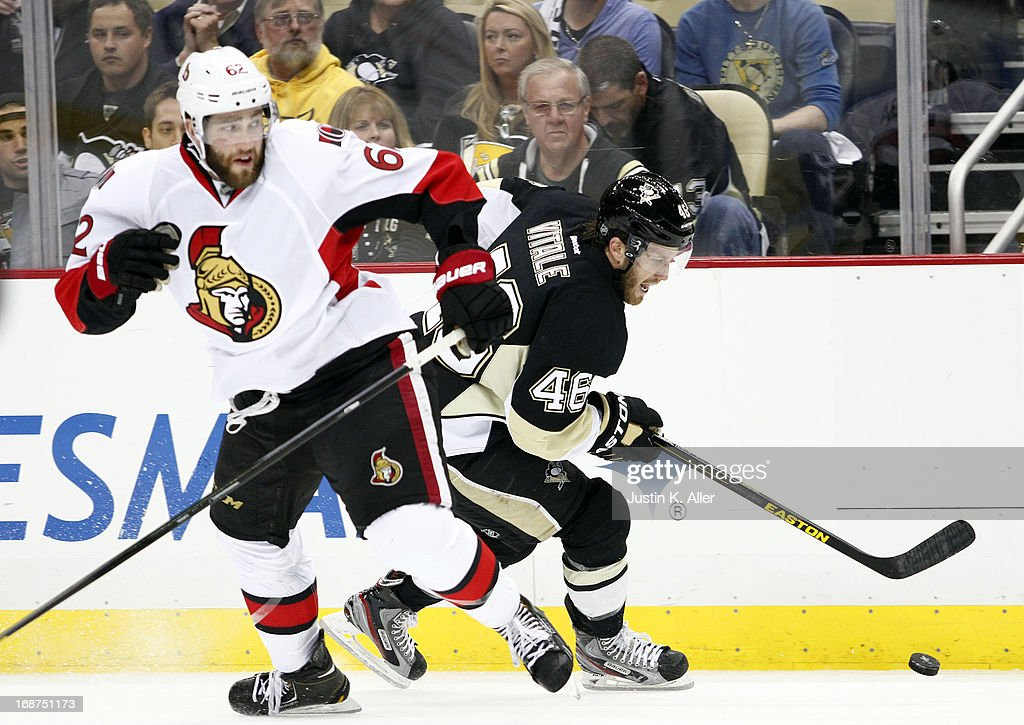 Joe Vitale #46 of the Pittsburgh Penguins handles the puck behind Eric Gryba #62 of the Ottawa Senators in Game One of the Eastern Conference Semifinals during the 2013 NHL Stanley Cup Playoffs at Consol Energy Center on May 14, 2013 in Pittsburgh, Pennsylvania.