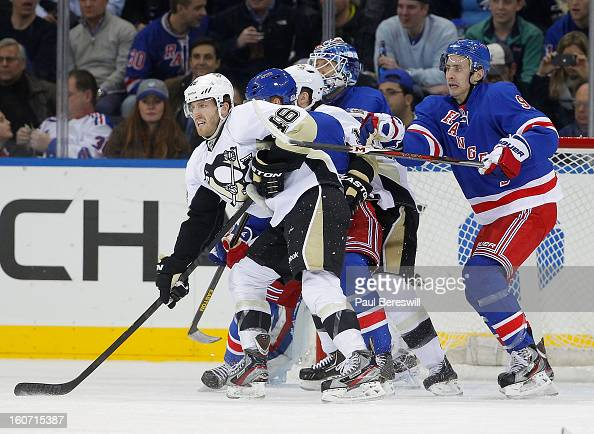 Joe Vitale of the Pittsburgh Penguins is covered by Matt Gilroy of the New York Rangers during an NHL hockey game at Madison Square Garden on January...