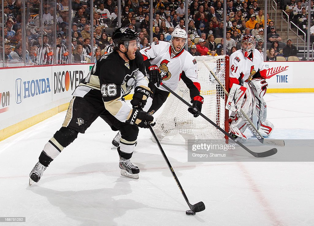 Joe Vitale #46 of the Pittsburgh Penguins moves the puck in front of Jared Cowen #2 of the Ottawa Senators in Game One of the Eastern Conference Semifinals during the 2013 NHL Stanley Cup Playoffs at Consol Energy Center on May 14, 2013 in Pittsburgh, Pennsylvania.