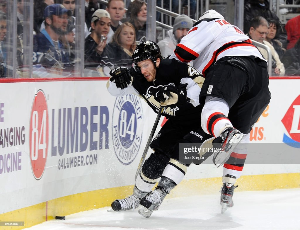 Joe Vitale #46 of the Pittsburgh Penguins upends <a gi-track='captionPersonalityLinkClicked' href=/galleries/search?phrase=Henrik+Tallinder&family=editorial&specificpeople=204661 ng-click='$event.stopPropagation()'>Henrik Tallinder</a> #7 of the New Jersey Devils while battling for the puck on February 2, 2013 at Consol Energy Center in Pittsburgh, Pennsylvania. Pittsburgh won the game 5-1.