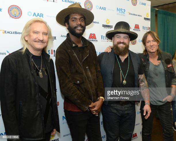 Joe Walsh Gary Carter Jr Zac Brown and Keith Urban poses in the press room during the VetsAid Charity Benefit concert at Eagle Bank Arena on...