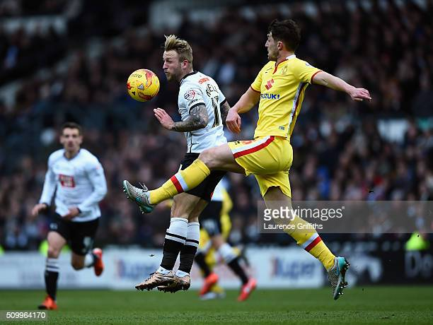 Joe Walsh of MK Dons battles with Johnny Russell of Derby County during the Sky Bet Championship match between Derby County and Milton Keynes Dons at...