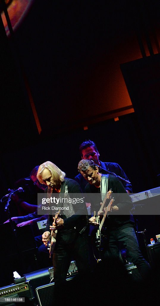 Joe Walsh of the Eagles and Steuart Smith perform during 'History Of The Eagles Live In Concert' at the Bridgestone Arena on October 16, 2013 in Nashville, Tennessee.