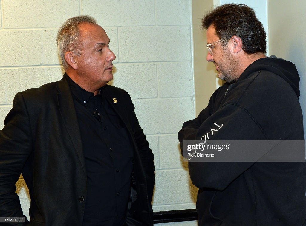 Joe Walsh Tour Manager Smokey Wendell and Singer/Songwriter Vince Gill backstage before the Eagles perform at the Bridgestone Arena on October 16, 2013 in Nashville, Tennessee.