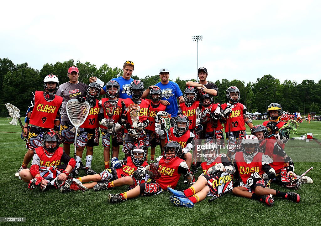 Joe Walters and Kyle Hartzell pose for a picture during halftime of the All-Star players guest coach Youth Tournament at Elon Park on July 13, 2013 in Charlotte, North Carolina.