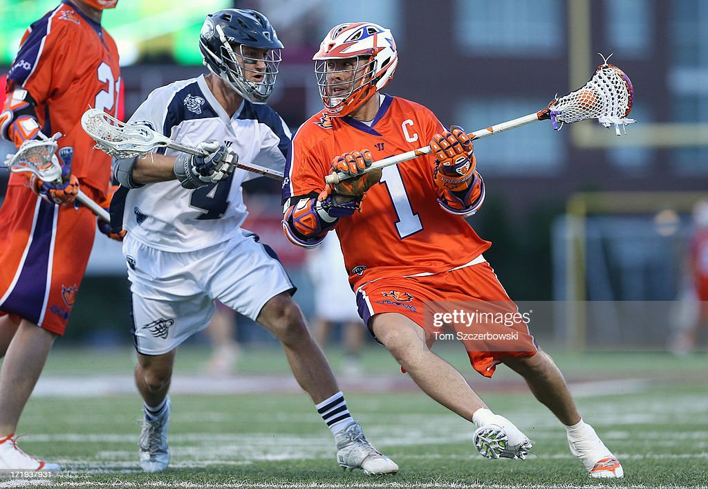 <a gi-track='captionPersonalityLinkClicked' href=/galleries/search?phrase=Joe+Walters+-+Lacrosse+Player&family=editorial&specificpeople=5983988 ng-click='$event.stopPropagation()'>Joe Walters</a> #1 of the Hamilton Nationals runs with the ball during Major League Lacrosse game action as Dan Burns #4 of the Chesapeake Bayhawks defends on June 29, 2013 at Ron Joyce Stadium in Hamilton, Ontario, Canada.