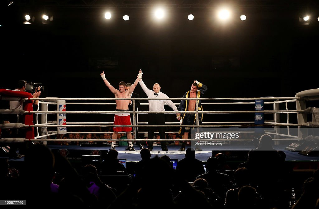 Joe Ward of British Lionhearts (L) celebrates his victory over <a gi-track='captionPersonalityLinkClicked' href=/galleries/search?phrase=Imre+Szello&family=editorial&specificpeople=4208661 ng-click='$event.stopPropagation()'>Imre Szello</a> of Italia Thunder during their 80-85kg bout in the World Series of Boxing between British Lionhearts and Italia Thunder on November 23, 2012 in Newport, Wales.