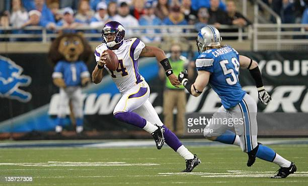 Joe Webb of the Minnesota Vikings runs for a first down as Bobby Carpenter of the Detroit Lions gives chase during the second quarter of the game at...