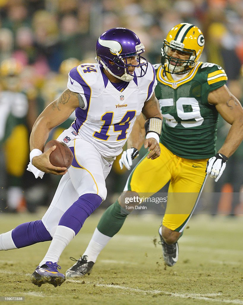 Joe Webb #14 of the Minnesota Vikings scrambles during an NFL game against the Green Bay Packers at Lambeau Field, January 5, 2013 in Green Bay, Wisconsin.
