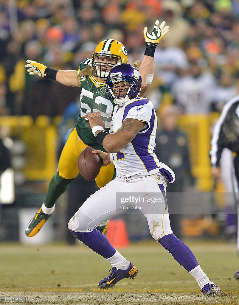 Joe Webb #14 of the Minnesota Vikings scrambles under pressure by Clay Matthews #52 of the Green Bay Packers during an NFL game against the Green Bay Packers at Lambeau Field, January 5, 2013 in Green Bay, Wisconsin.