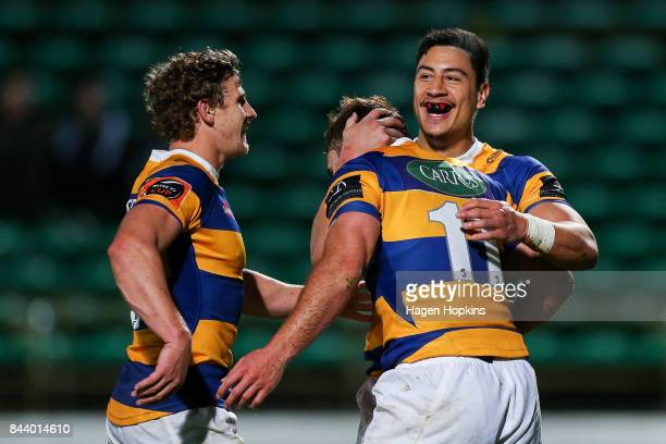 Joe Webber of Bay of Plenty celebrates his try with Lalakai Foketi and Richard Judd during the round four Mitre 10 Cup match between Manawatu and Bay...
