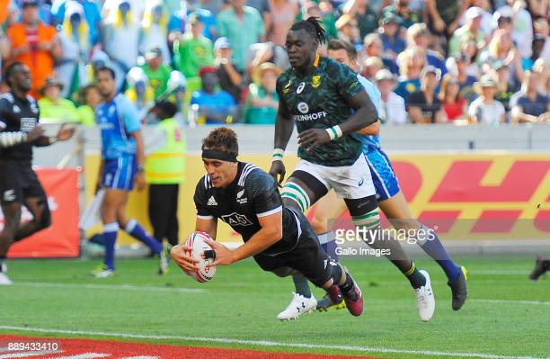 Joe Webber of New Zealand scores a try during day 2 of the 2017 HSBC Cape Town Sevens Semi Final match between South Africa and New Zealand at Cape...