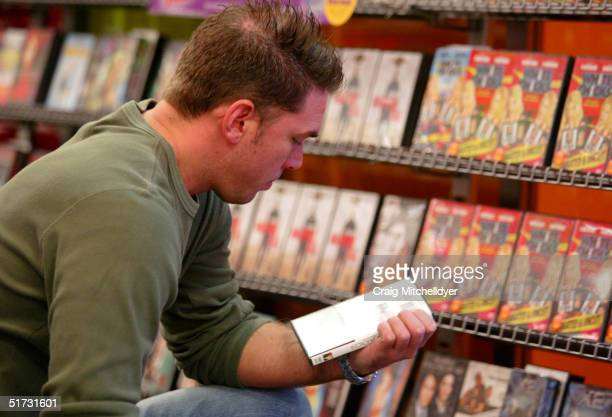 Joe Webber of Wilsonville OR searches for a rental at a Blockbuster Video store on November 11 2004 in Wilsonville Oregon Blockbuster Inc offered to...
