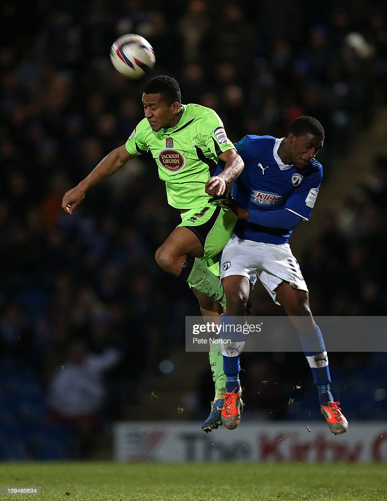 Joe Widdowson of Northampton Town heads the ball away from Tendayi Darikwa of Chesterfield during the npower League Two match between Chesterfield and Northampton Town at the Proact Srtadium on January 12, 2013 in Chesterfield, England.