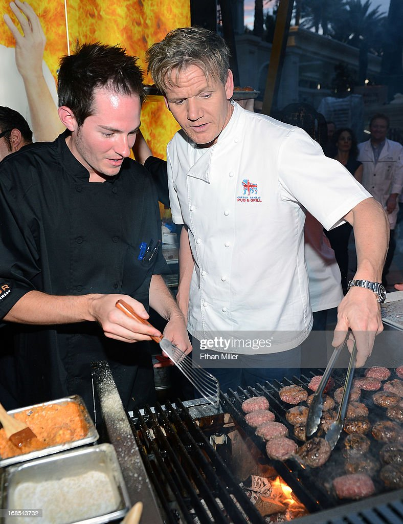 Joe Wilkins (L) and television personality and chef <a gi-track='captionPersonalityLinkClicked' href=/galleries/search?phrase=Gordon+Ramsay&family=editorial&specificpeople=210520 ng-click='$event.stopPropagation()'>Gordon Ramsay</a> cook at the <a gi-track='captionPersonalityLinkClicked' href=/galleries/search?phrase=Gordon+Ramsay&family=editorial&specificpeople=210520 ng-click='$event.stopPropagation()'>Gordon Ramsay</a> BurGR booth at Vegas Uncork'd by Bon Appetit's Grand Tasting event at Caesars Palace on May 10, 2013 in Las Vegas, Nevada.