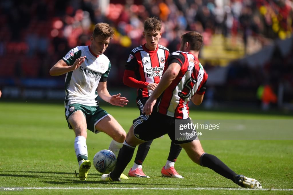 Joe Williams of Barnsley is tackled by Jack O'Connell of Sheffield United during the Sky Bet Championship match between Sheffield United and Barnsley at Bramall Lane on August 19, 2017 in Sheffield, England.