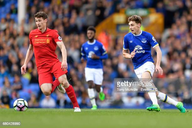 Joe Williams of Everton and Matty Virtue during the Premier League 2 match between Everton U23 and Liverpool U23 at Goodison Park on May 8 2017 in...