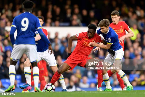 Joe Williams of Everton and Ovie Ejaria challenge for the ball during the Premier League 2 match between Everton U23 and Liverpool U23 at Goodison...