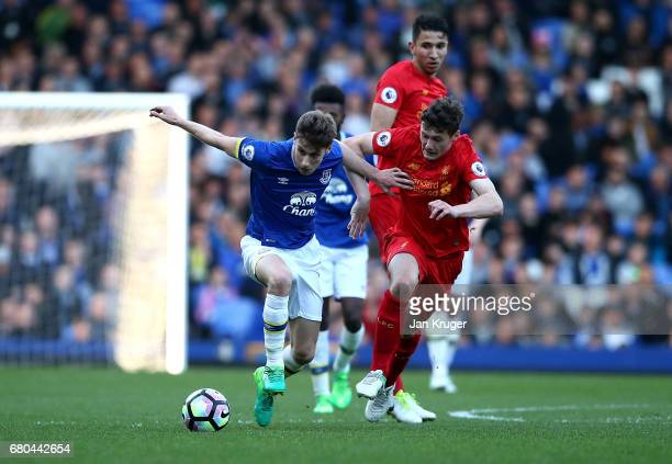 Joe Williams of Everton holds off Matty Virtue of Liverpool during the Premier League 2 match between Everton and Liverpool at Goodison Park on May 8...