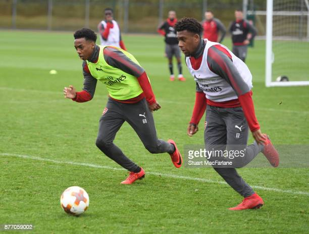 Joe Willock and Alex Iwobi of Arsenal during a training session at London Colney on November 21 2017 in St Albans England