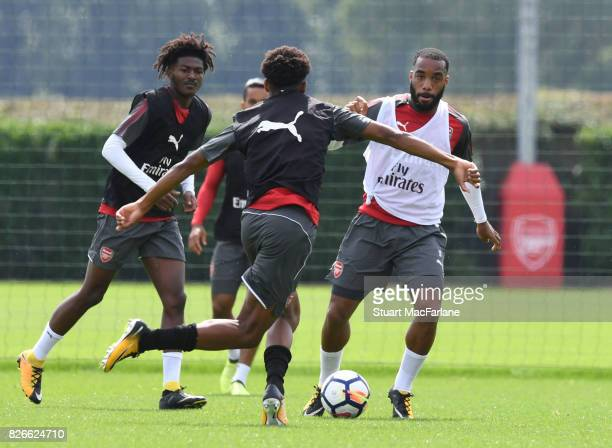Joe Willock and Alex Lacazette of Arsenal during a training session at London Colney on August 5 2017 in St Albans England