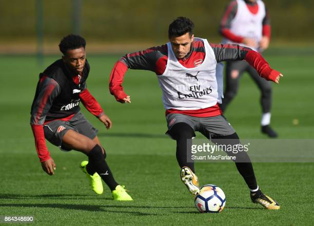 Joe Willock and Alexis Sanchez of Arsenal during a training session at London Colney on October 21 2017 in St Albans England