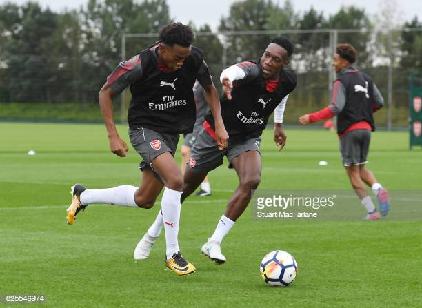 Joe Willock and Danny Welbeck of Arsenal during a training session at London Colney on August 2 2017 in St Albans England