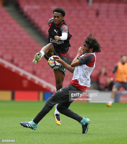 Joe Willock and Mohamed Elneny of Arsenal during a training session at Emirates Stadium on August 3 2017 in London England