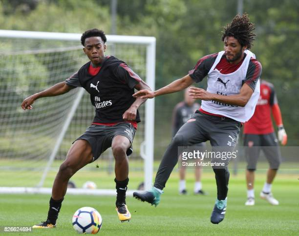 Joe Willock and Mohamed Elneny of Arsenal during a training session at London Colney on August 5 2017 in St Albans England