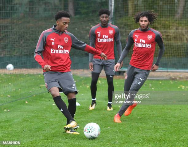 Joe Willock and Mohamed Elneny of Arsenal during a training session at London Colney on October 23 2017 in St Albans England