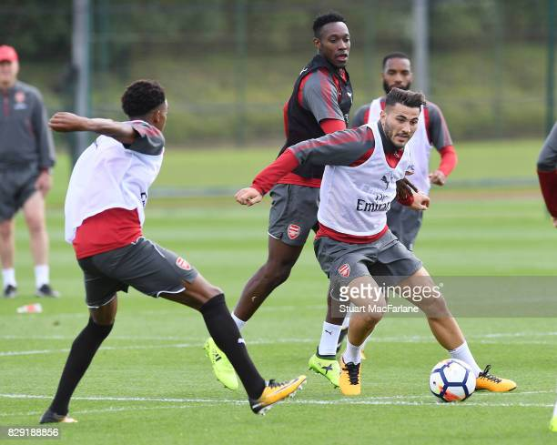 Joe Willock Danny Welbeck and Sead Kolasinac of Arsenal during a training session at London Colney on August 10 2017 in St Albans England