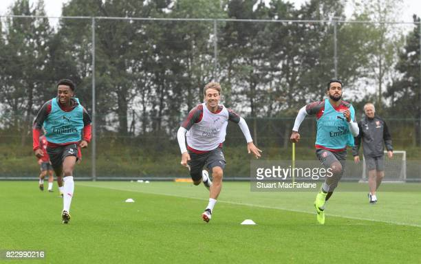 Joe Willock Nacho Monreal and Theo Walcott of Arsenal during a training session at London Colney on July 26 2017 in St Albans England