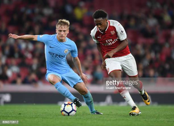 Joe Willock of Arsenal breaks past Matthew Smith of Man City during the Premier League 2 match between Arsenal and Manchester City at Emirates...