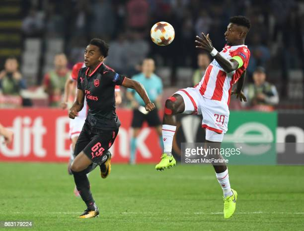 Joe Willock of Arsenal breaks past Mitchell Donald of Red Star during the UEFA Europa League group H match between Crvena Zvezda and Arsenal FC at...