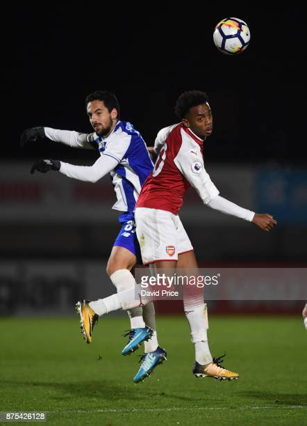Joe Willock of Arsenal is challenged by Bruno Costa of Porto during the match between Arsenal U23 and Porto at Meadow Park on November 17 2017 in...
