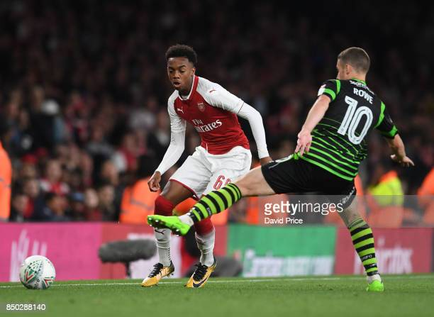 Joe Willock of Arsenal passes the ball under pressure from Tommy Rowe of Doncaster during the match between Arsenal and Doncaster Rovers at Emirates...