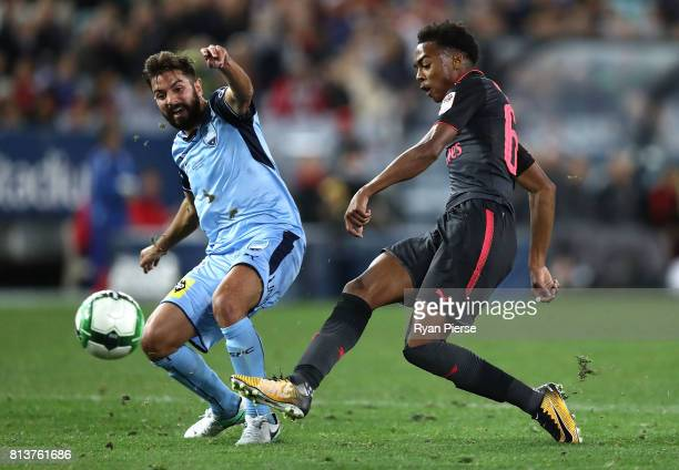 Joe Willock of Arsenal shoots past Michael Zullo of Sydney FC during the match between Sydney FC and Arsenal FC at ANZ Stadium on July 13 2017 in...