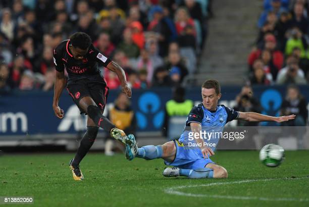 Joe Willock of Arsenal shoots under pressure from Brandon O'Neill of Sydney FC during the preseason friendly match between Sydney FC and Arsenal at...