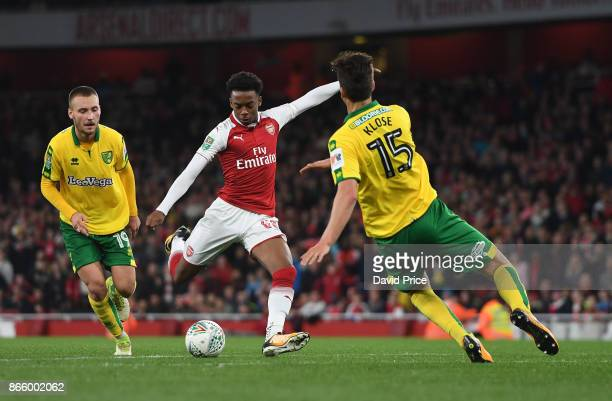 Joe Willock of Arsenal shoots under pressure from Timm Klose of Norwich during the Carabao Cup Fourth Round match between Arsenal and Norwich City at...