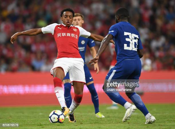 Joe Willock of Arsenal takes on Jeremie Boga of Chelsea during the pre season friendly between Arsenal and Chelsea at the Birds Nest on July 22 2017...