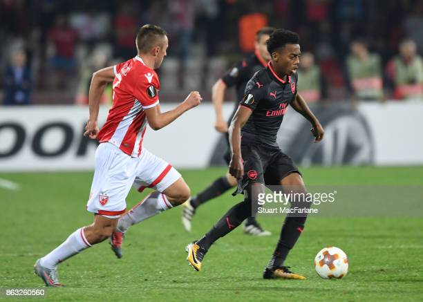 Joe Willock of Arsenal takes on Nenad Krsticic of Red Star during the UEFA Europa League group H match between Crvena Zvezda and Arsenal FC at Rajko...