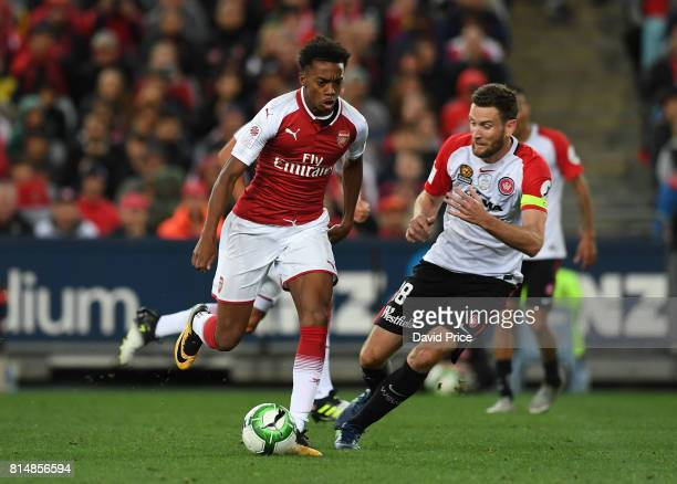 Joe Willock of Arsenal takes on Robert Cornthwaite of Western Sydney during the match between the Western Sydney Wanderers and Arsenal FC at ANZ...