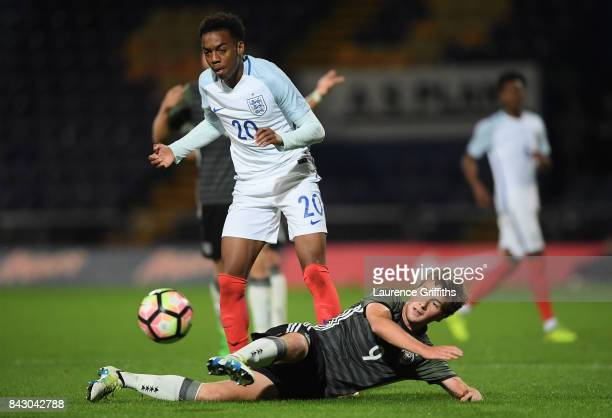 Joe Willock of England and Yari Otto of Germany battle for possession during the U19 International match between England and Germany at One Call...