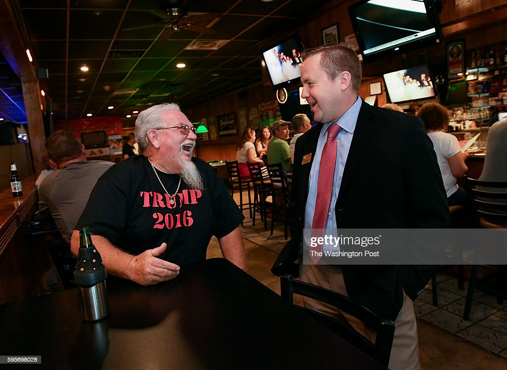 Joe Wolf left of Manassas jokes around with Corey Stewart Virginia chairman of Trump for President as he talks with patrons prior to a Veterans for...