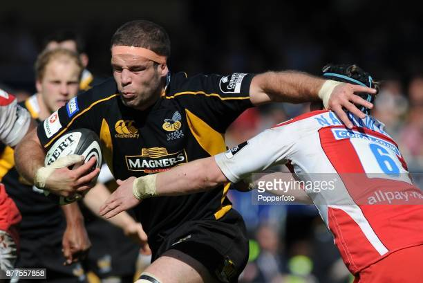 Joe Worsley of London Wasps drives through the tackle of Luke Narraway of Gloucester Rugby during a Guinness Premiership match between London Wasps...