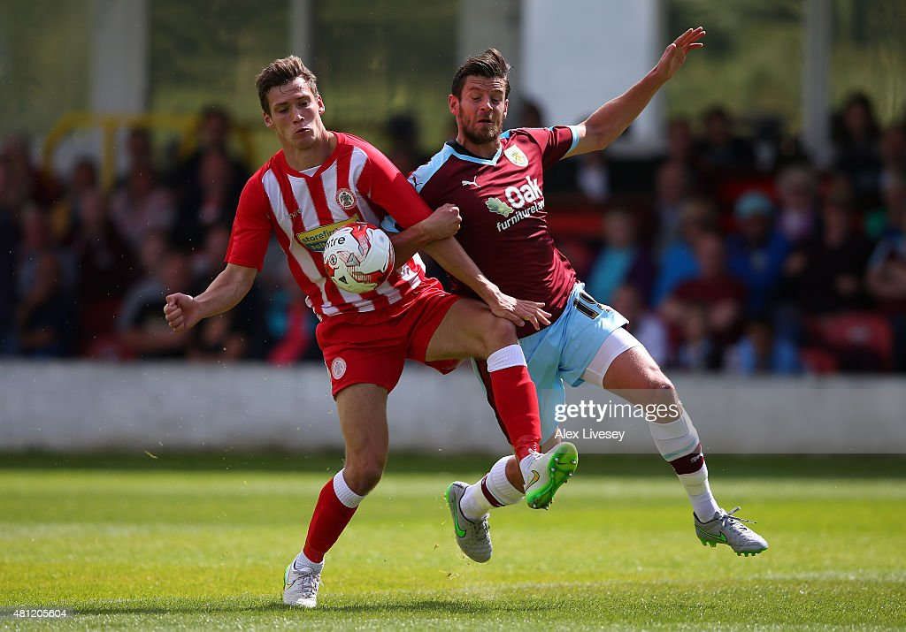 Joe Wright of Accrington Stanley and Lukas Jutkiewicz of Burnley battle for the ball during a Pre Season Friendly match between Accrington Stanley...