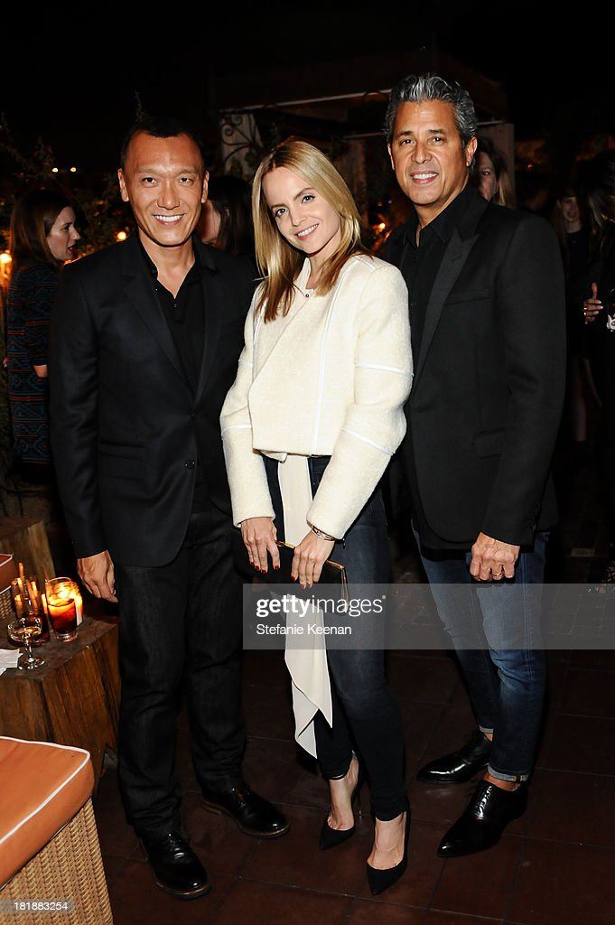 Joe Zee, Mena Suvari and Jeff Rudes attend an intimate dinner event hosted by Elle magazine and J Brand at Petit Ermitage Hotel on September 25, 2013 in West Hollywood, California.